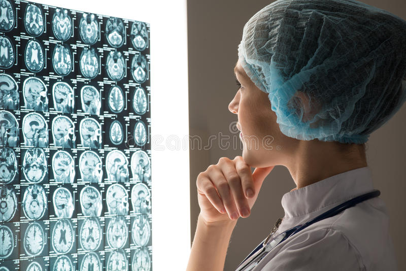 Doctor looking at the x-ray royalty free stock image