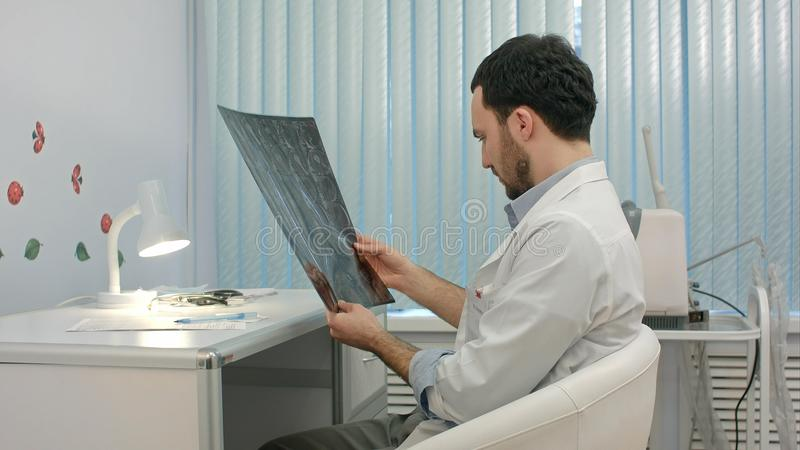 Doctor looking at the x-ray picture of lungs in hospital. People. Professional shot in 4K resolution. You can use it e.g. in your commercial video, business stock photos