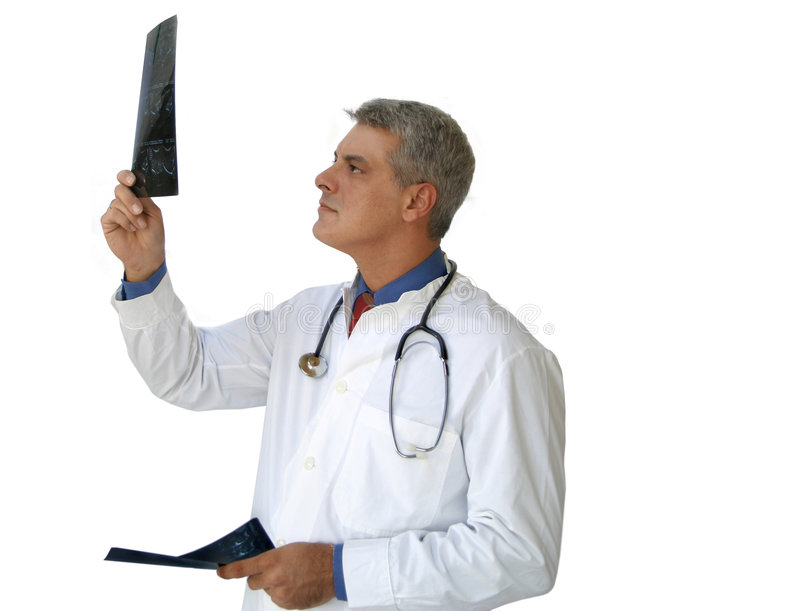 Doctor looking at x-rays stock photos