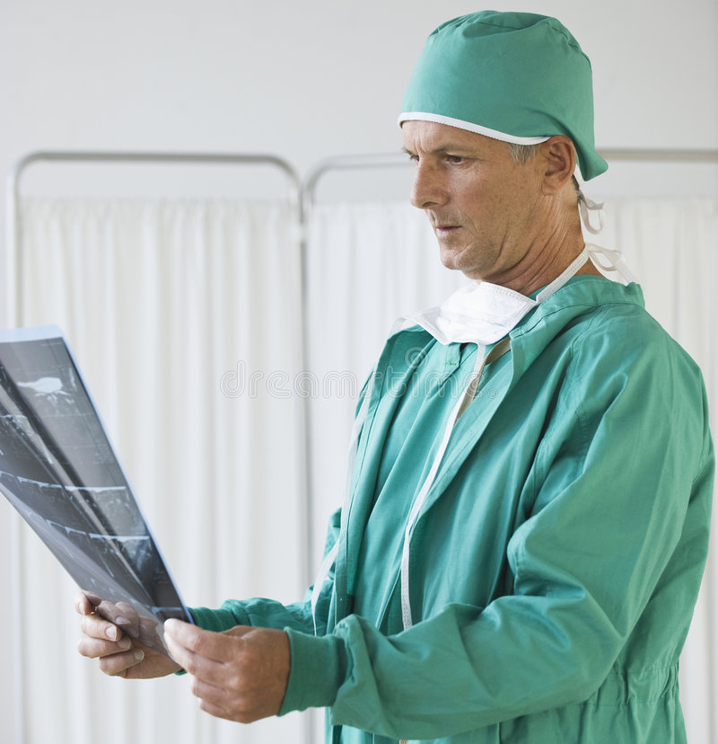 Doctor looking at x-rays royalty free stock photography