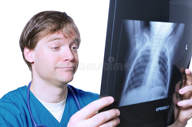 Doctor looking at xray. With comical expression royalty free stock photos