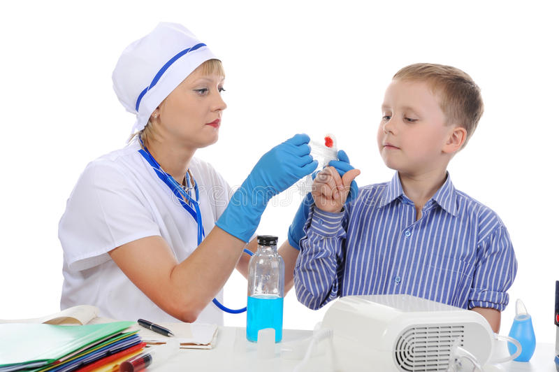 Download Doctor makes a bandage stock photo. Image of child, childhood - 15620508