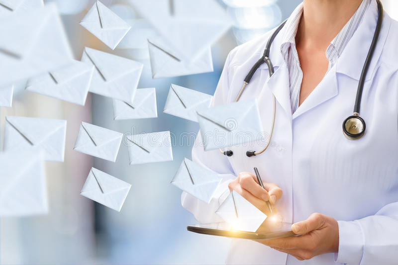 Doctor makes sending email . stock images