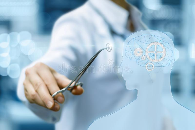 Doctor makes the treatment of the patient`s brain . royalty free stock image