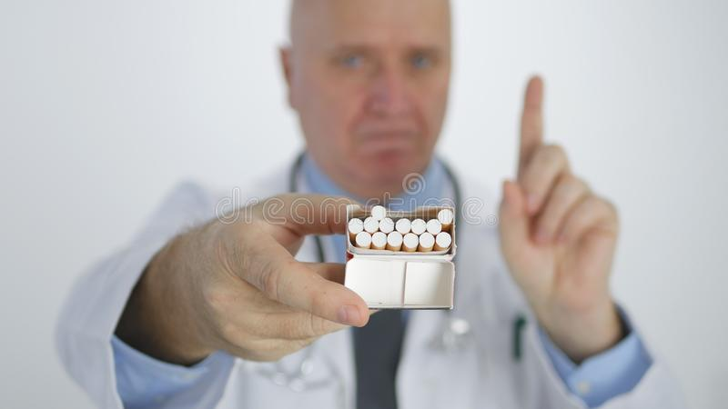 Doctor Making a Disagree Gestures with Cigarette in Anti Tobacco Campaign royalty free stock photo