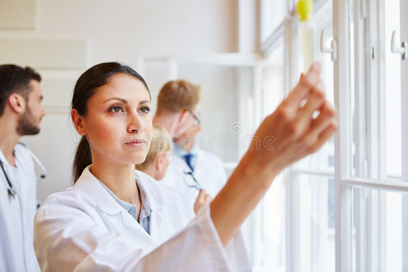 Doctor making drug test. With colleagues at hospital royalty free stock photography