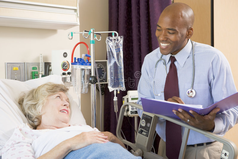 Doctor Making Notes About Patient royalty free stock image
