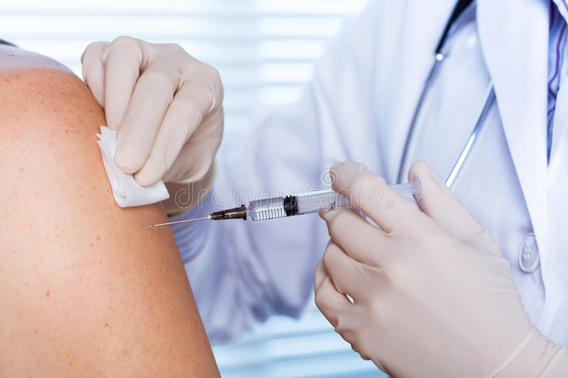 Doctor making a vaccination royalty free stock photo