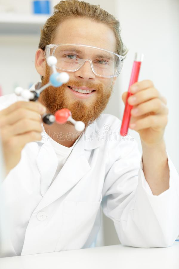 Doctor man interacting with 3d dna strand stock image