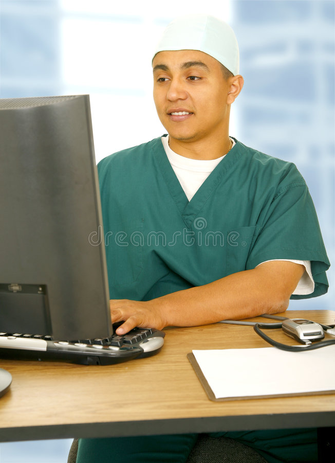 Download Doctor Man Using Computer stock photo. Image of green - 5643220