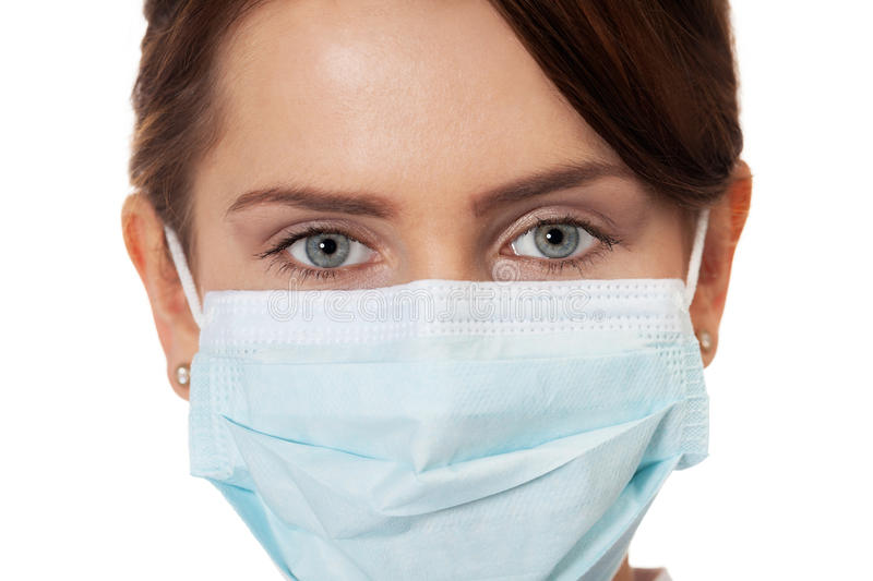Doctor in mask. Close up of a doctor in surgical mask stock image