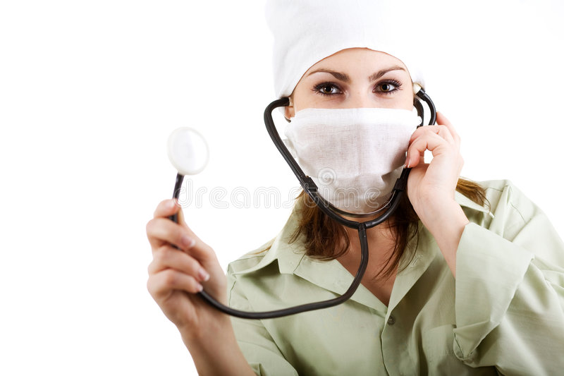 Doctor in mask. An image of a doctor in mask with stethoscope stock photos