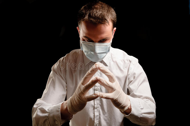 Doctor with mask and syringe stock image