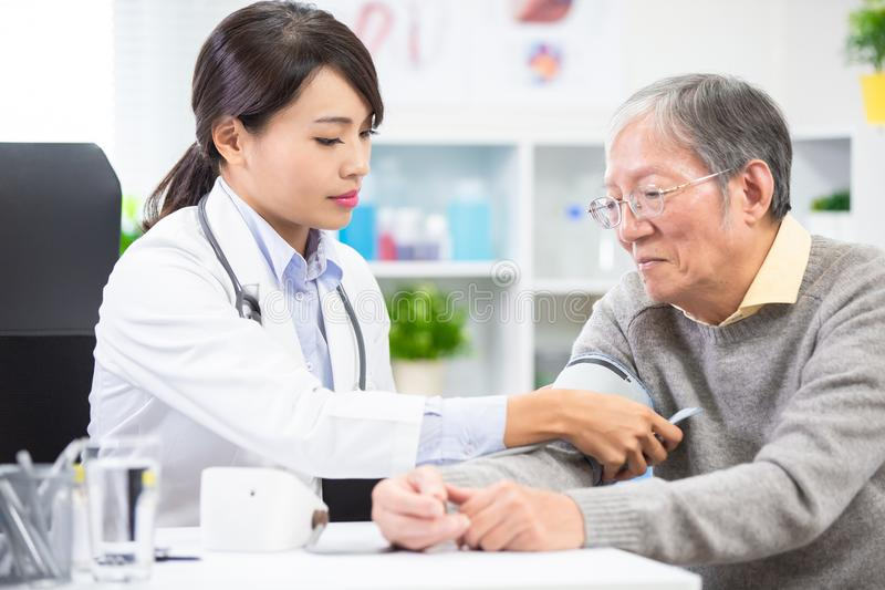 Doctor measure blood pressure royalty free stock photos