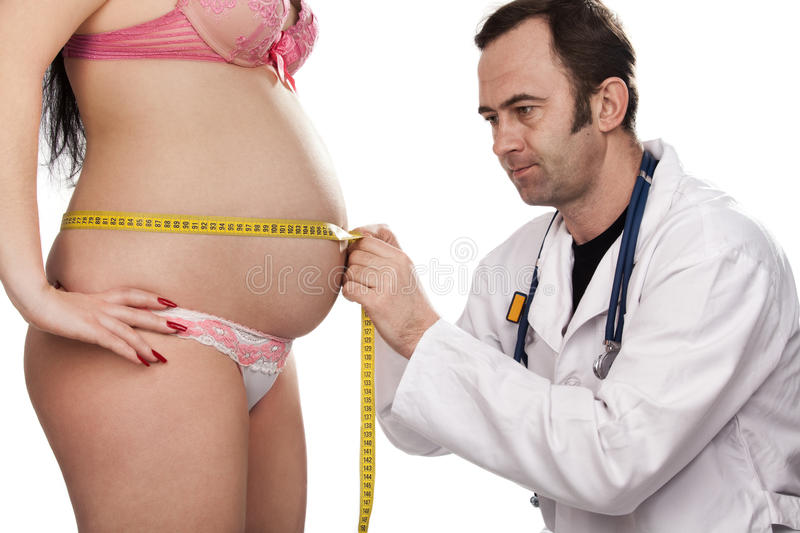 Doctor Measures Belly Of The Pregnant Woman Stock Image