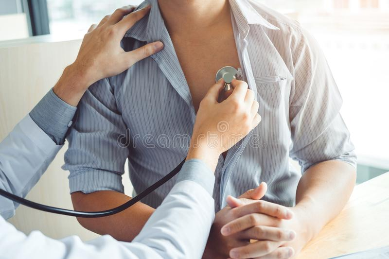Doctor Measuring arterial blood pressure man patient Health care in hospital. Doctor Measuring arterial blood pressure men patient Health care in hospital stock photo