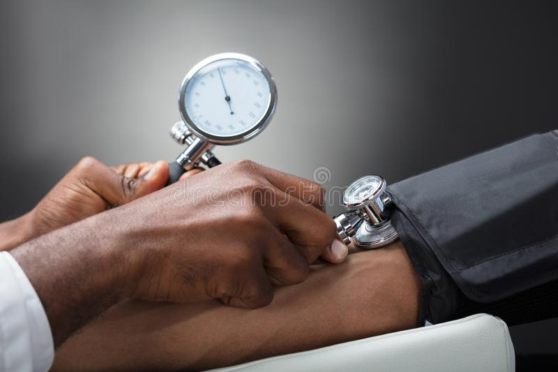 Doctor Measuring Blood Pressure stock photo