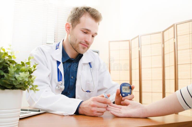 Doctor measuring of blood sugar for diabetes patient. Diabetes blood glucose test patient doctor sugar diabetic concept royalty free stock photos