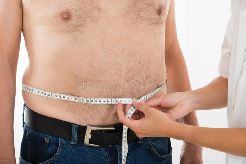 Doctor Measuring Person`s Waist royalty free stock image