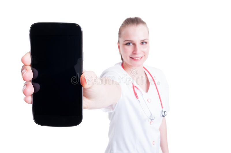 Doctor or medic female presenting blank screen mobile phone royalty free stock photo