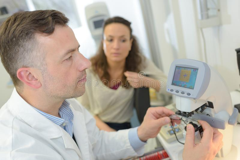 Doctor with medical handheld device. Doctor stock photography