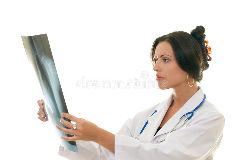 Doctor or medical professional analysing a patient's x-ray royalty free stock photography