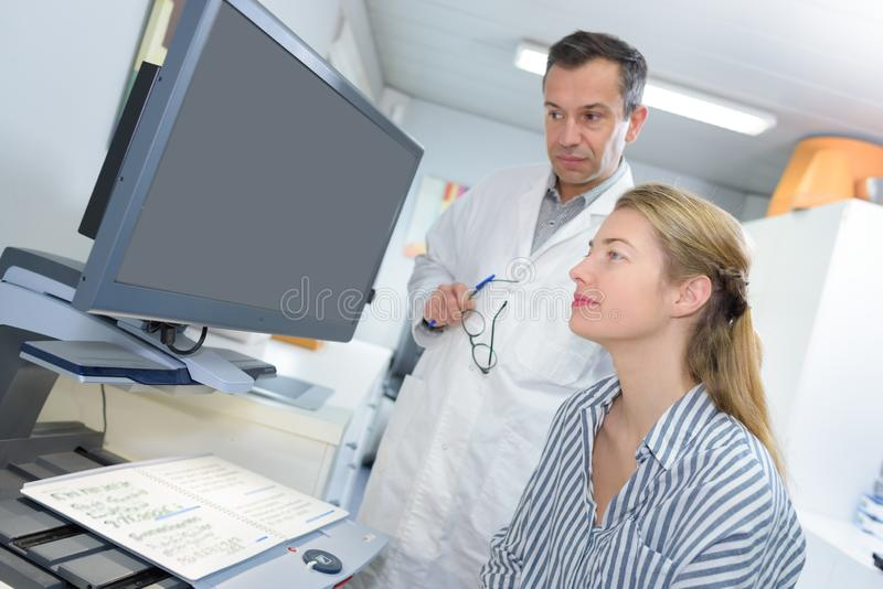 Doctor and medical secretary royalty free stock photo