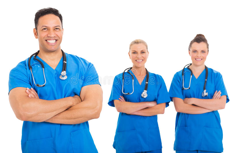 Doctor medical team. Happy middle aged doctor with medical team on background royalty free stock photos