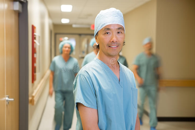 Doctor With Medical Team Walking In Hospital stock image