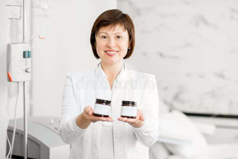 Doctor with medicine bottles stock photos
