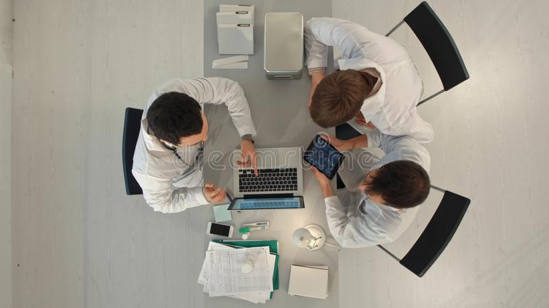 Doctor Meeting Teamwork Diagnosis Healthcare Concept. Top view stock images