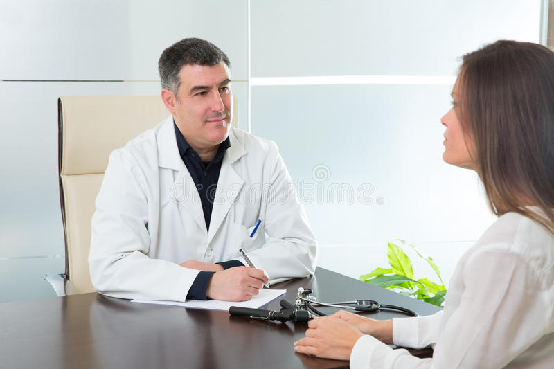 Doctor Man And Patient Woman On Hospital Office Talking Royalty Free Stock Photo