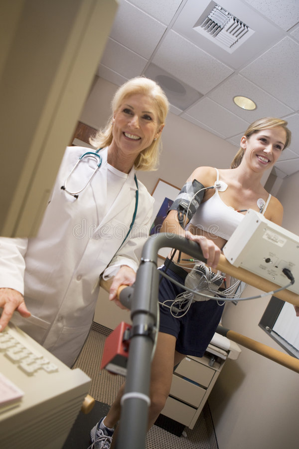 Download Doctor Monitoring Female Patient On Treadmill Stock Photos - Image: 9002683