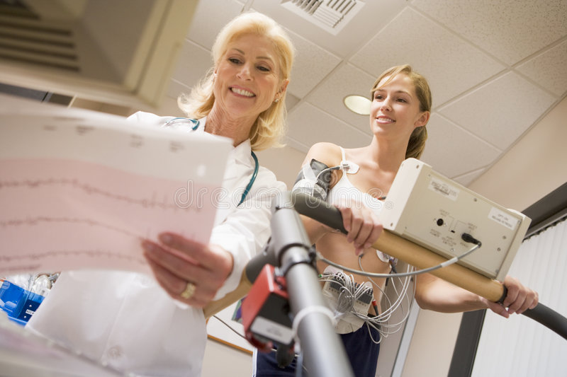 Download Doctor Monitoring Female Patient On Treadmill Stock Image - Image: 9002699
