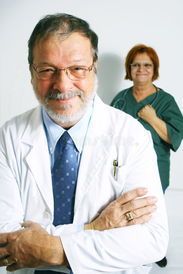 Doctor and nurse. Mature doctor and a nurse on a white background royalty free stock photography