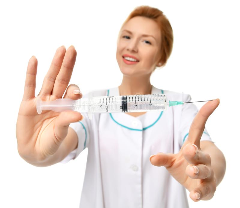 Doctor or nurse with big syringe needle for flu injection vaccination concept. Isolated on white background royalty free stock photography