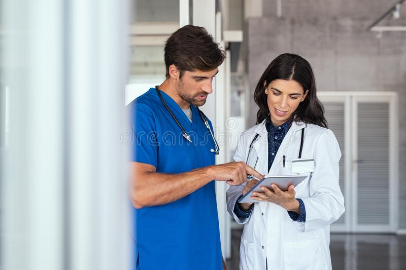 Doctor and nurse discussing report royalty free stock images