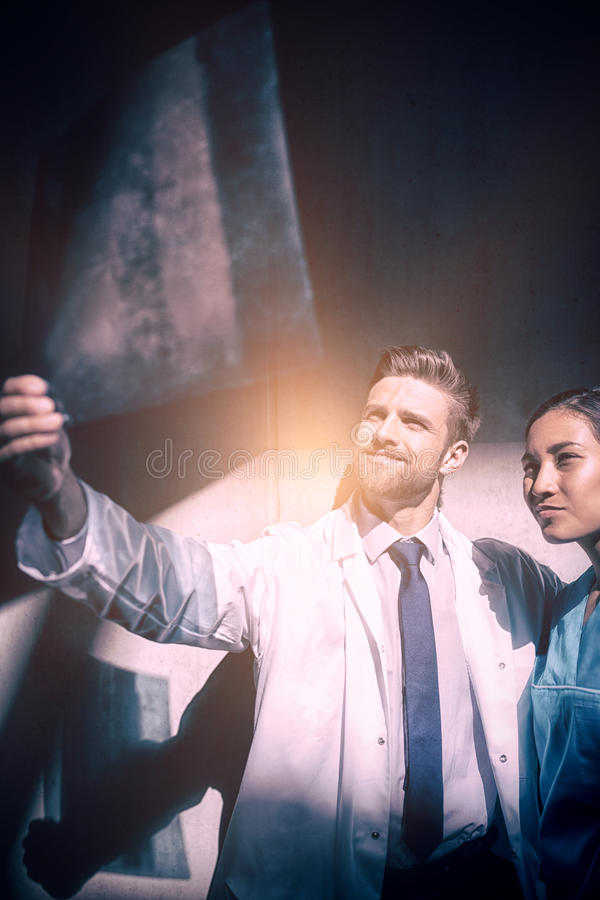 Doctor and nurse examining X-ray report. At hospital royalty free stock photography