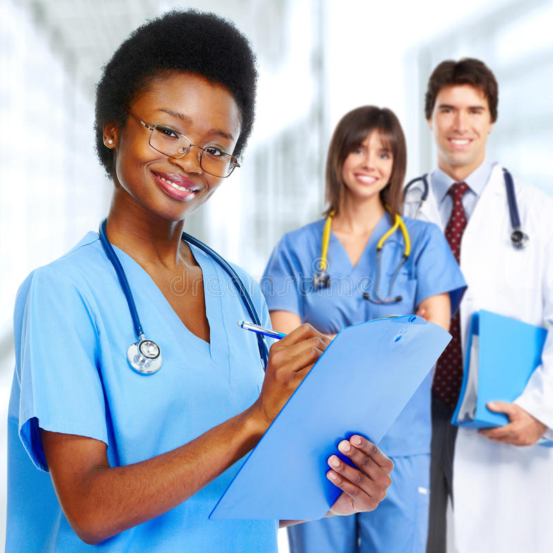Doctor and nurse. Group of doctors and nurses in medical clinic stock photo