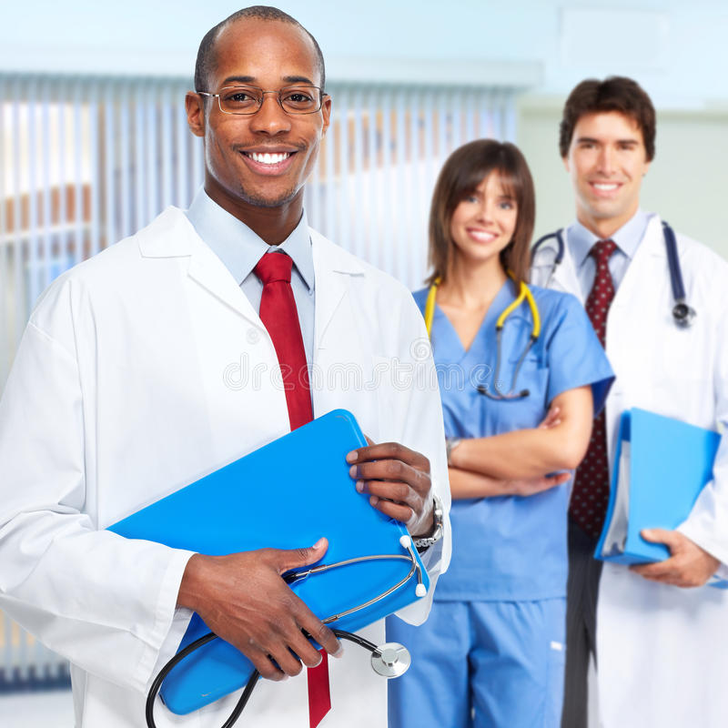 Doctor and nurse. Group of doctors and nurses in medical clinic royalty free stock photo
