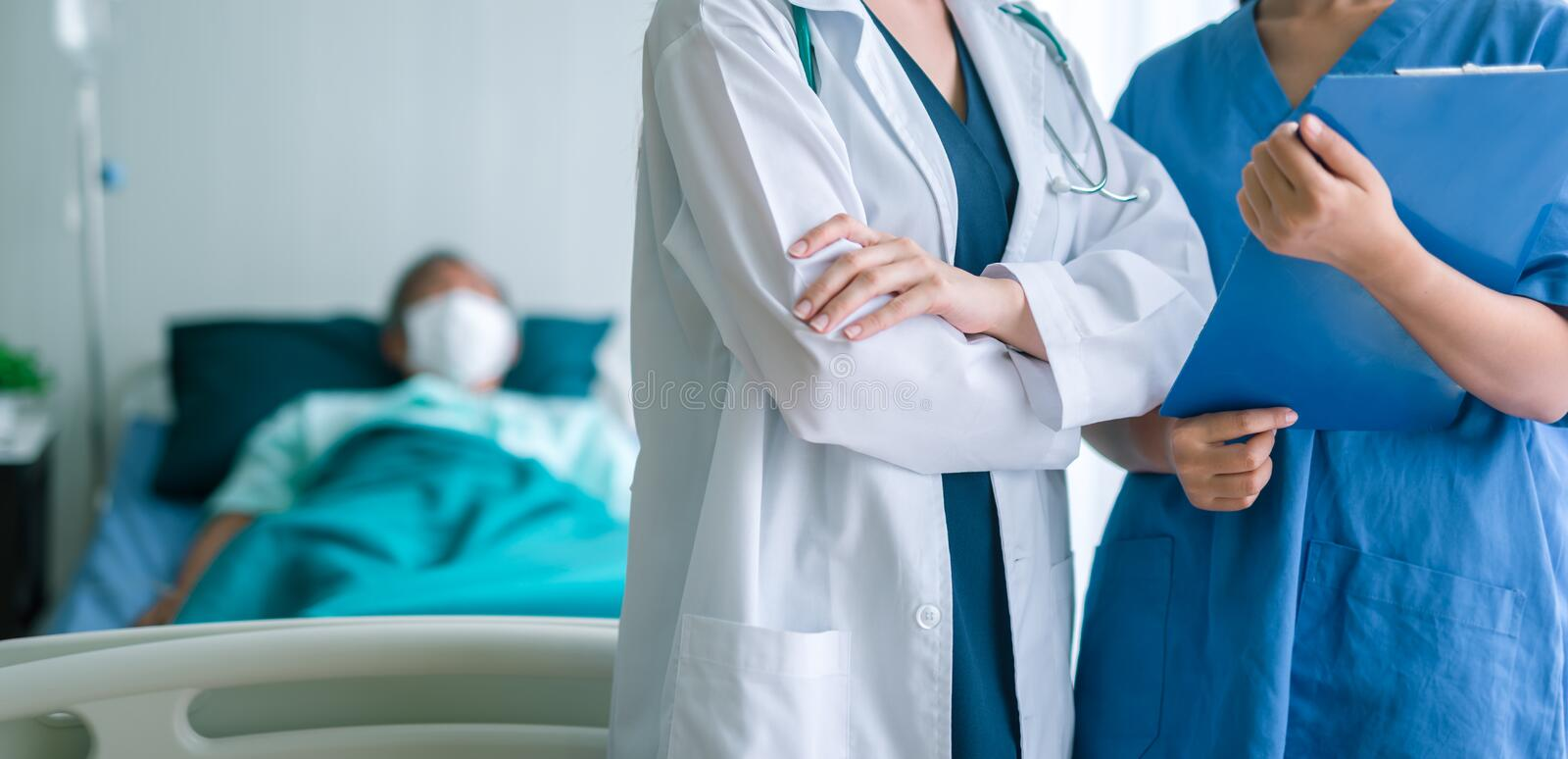 Doctor and Nurse medical team With Patient In Background. royalty free stock photo