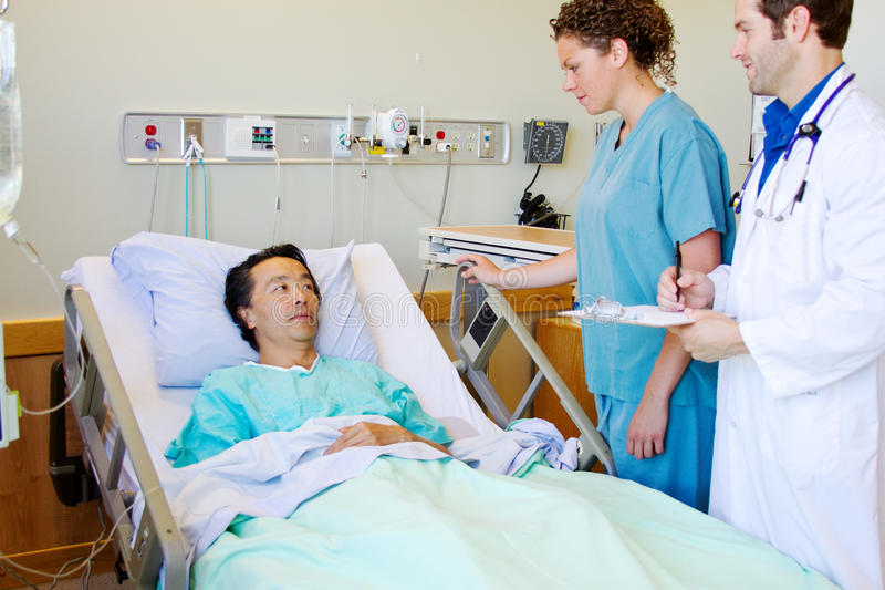 Doctor and nurse with patient stock photos