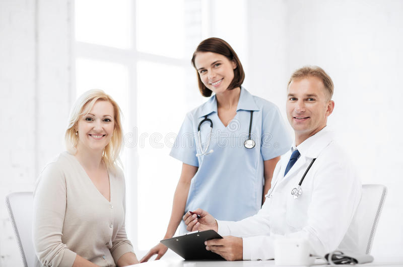 Doctor And Nurse With Patient In Hospital Stock Photo