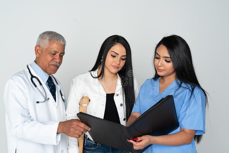Doctor and Nurse With Patient On White Background. Doctor and nurse at the hospital with a patient stock image