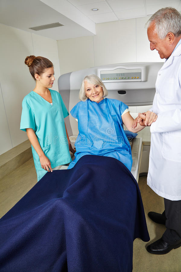 Doctor and nurse with senior patient at MRI stock photo
