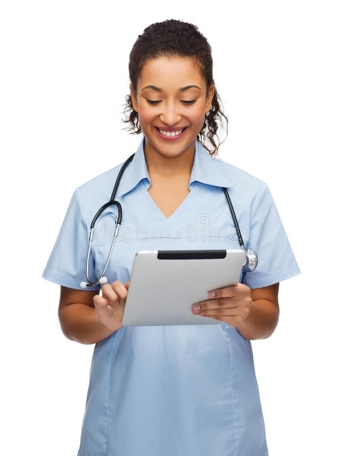Doctor or nurse with stethoscope and tablet pc stock image