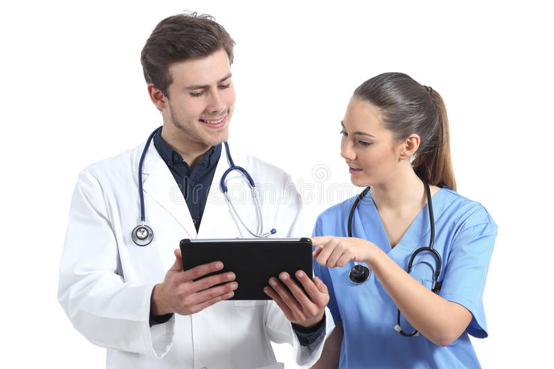 Doctor and nurse student working with a tablet stock photography
