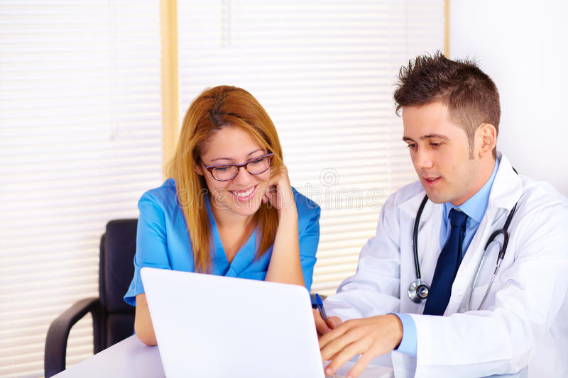 Download Doctor and a nurse talking stock photo. Image of friendly - 22934448