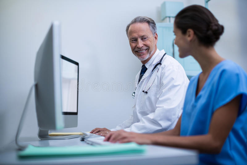 Doctor and nurse working on computer. In hospital royalty free stock photos