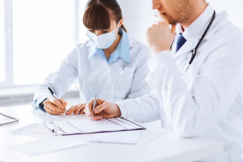Download Doctor And Nurse Writing Prescription Paper Stock Photo - Image: 32480032
